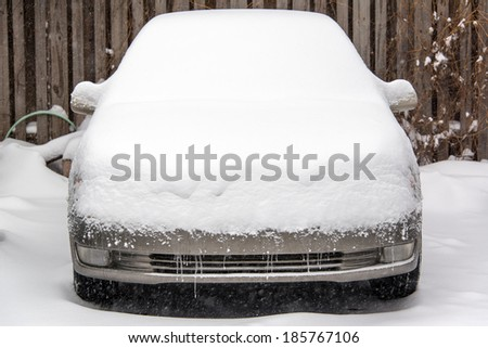 Car covered in several inches of snow in Chicago - stock photo