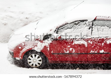 Car covered with fresh white snow - stock photo
