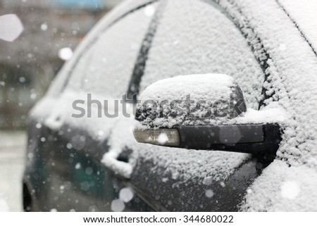 car covered with snow - stock photo