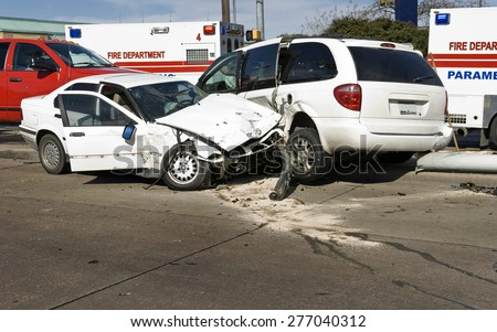 Car crash accident on street with damaged automobiles after collision/ Car Crash - stock photo