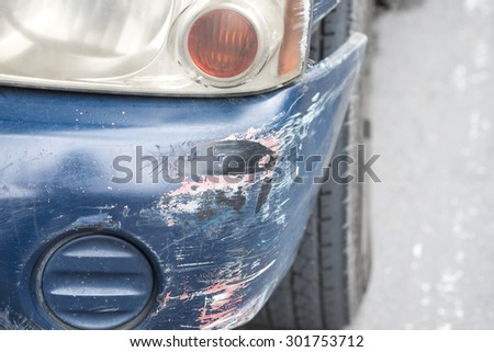 Car crashed with damaged bumper on the road  - stock photo