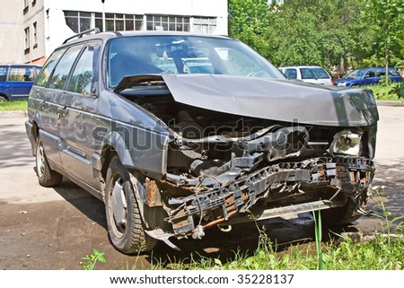 Car damaged in result of accident - stock photo
