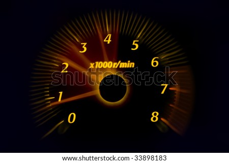 Car dashboard gauges illuminated at night, motion look - stock photo