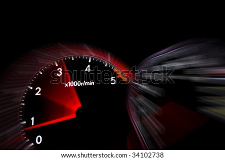 Car dashboard gauges illuminated at night, motion look