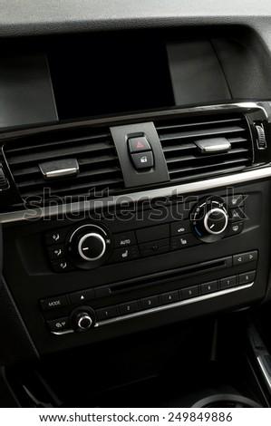 Car dashboard. Interior detail. Vertical photo. - stock photo