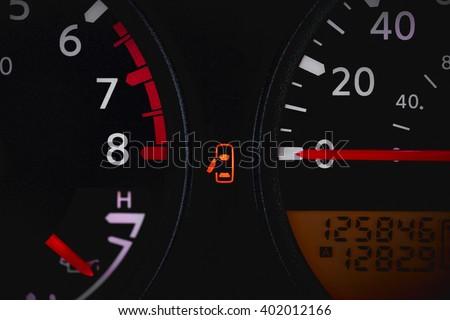 Car dashboard showing door ajar warning light - stock photo