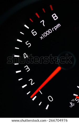 car dashboard speedometer tachometer macro