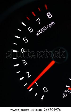 car dashboard speedometer tachometer macro - stock photo