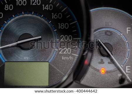 Car dashboard with speed, temperature and fuel indicator.