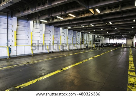 Car deck with cars and trucks on a ferry sailing the Mediterranean Sea