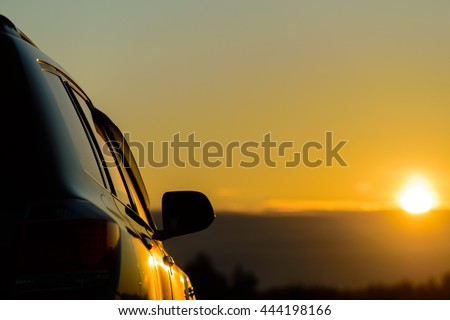 Car detail in the sunset - stock photo