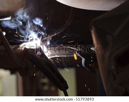 Car detail of welding , Welder at work - stock photo