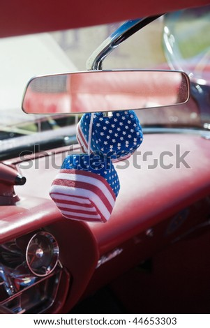 Car dice with american flag - stock photo