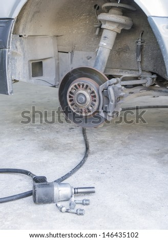 Car disc brakes pneumatic wrench tool for replacement tire - stock photo