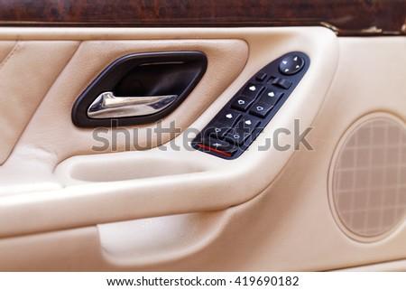 Car door handle with power window control unit - stock photo