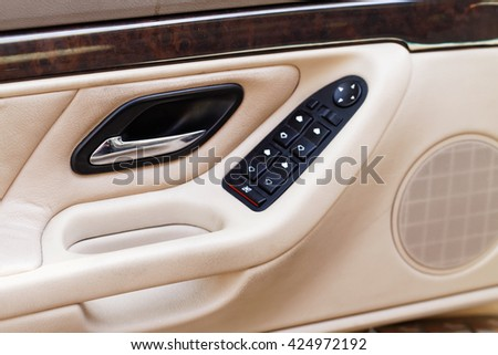 Car door handle with power window control unit - stock photo
