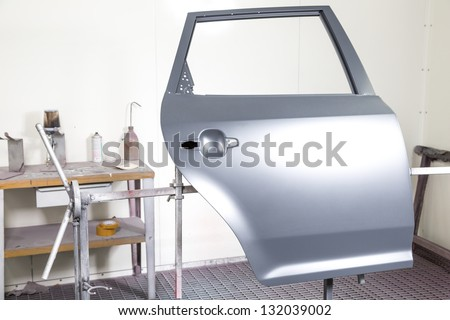 Car door prepared to be painted by car body painter - stock photo