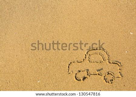 Car drawn on the beach sand - stock photo