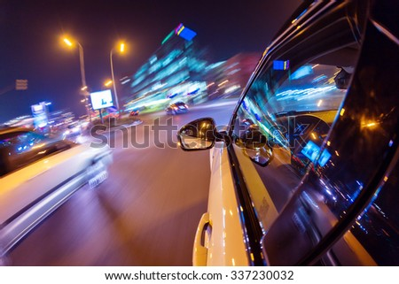 Car driving at night city with blur motion  - stock photo