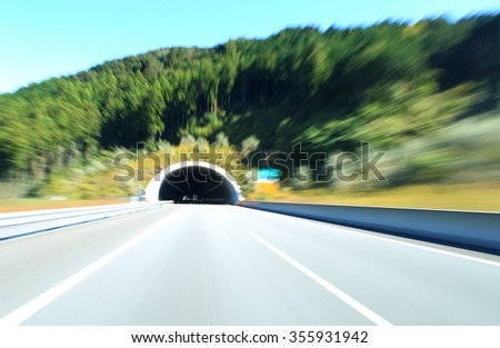 Car driving on highway , motion blur