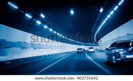 car driving through tunnel - stock photo