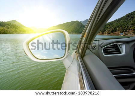 Car drove over the lake (the future concept car that can travel in water) - stock photo