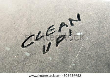 Car dust word on dirty rear window of the car and inscription CLEAN UP!. Front and side view of mirror. Wash me car. Close up of text with handwriting. - stock photo
