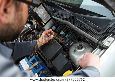 Car electric repair,  Repair of electrical wiring in the car.  - stock photo