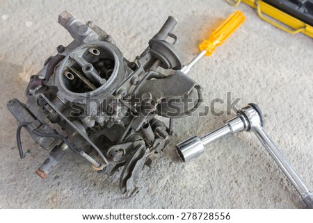Car engine carburetor with wrench ratchet set - stock photo