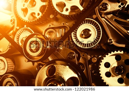 Car engine closeup, focus on pulley - stock photo