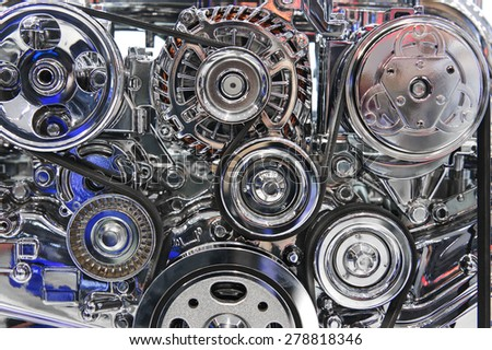 Car engine. Fragment of modern automobile motor with metal and chrome steel parts - stock photo