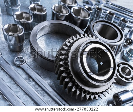 Car engine parts on metal background