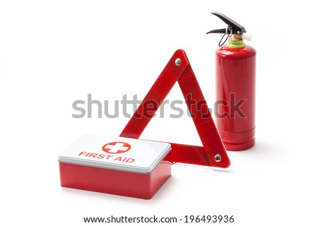 Car equipment - triangle, extinguisher and first aid kit. - stock photo