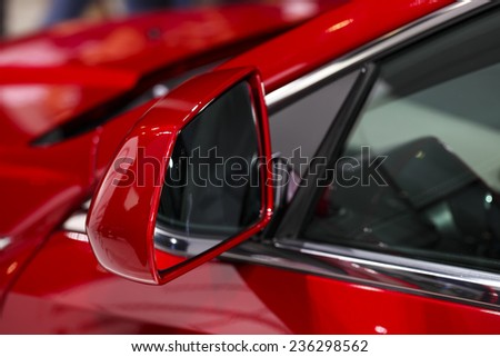 car exhibition  new car rear view mirror  - stock photo