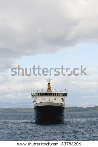 Car ferry sailing in the scottish highlands - stock photo