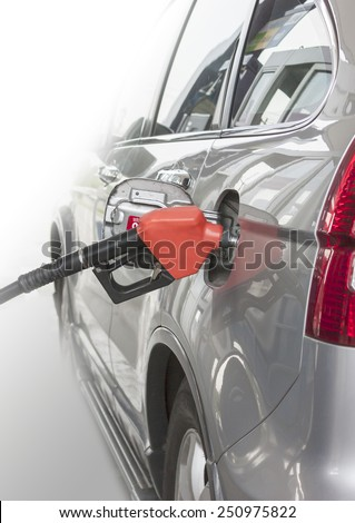 car filling the gas at the station