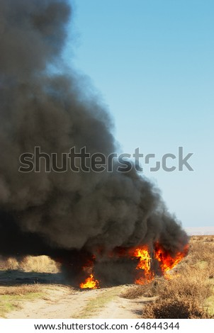 Car fire on desert rural road