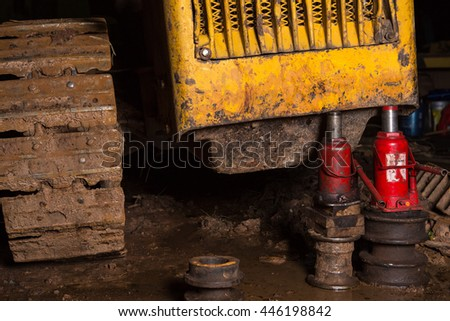 Car fixed in the garage, Hydraulic floor jack lift a car, Car without wheel, wheel without tire. - stock photo