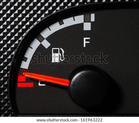 Car fuel gauge low - stock photo