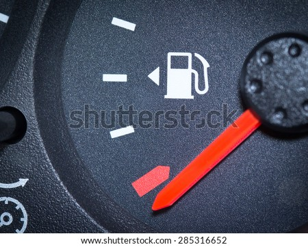 Car Fuel Gauge Showing Empty, close up - stock photo
