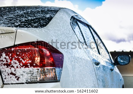 car getting a wash with soap - stock photo