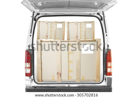car go boxes in open back door of white van with isolated white background - stock photo