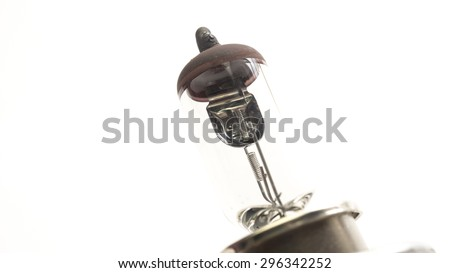 Car halogen bulb or headlight lamp. Concept of safety light and bright technology idea. Isolated on white background. Slightly de-focused and close-up shot. Copy space. - stock photo