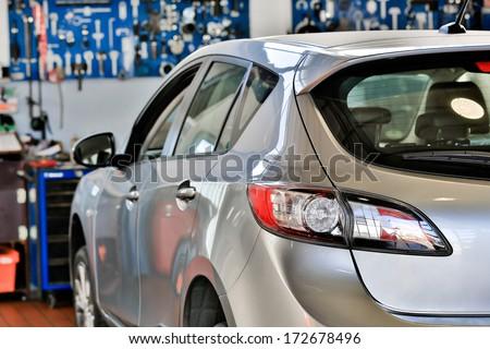 Car in a auto repair garage - stock photo