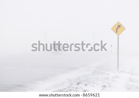 Car in Blowing Snow - stock photo