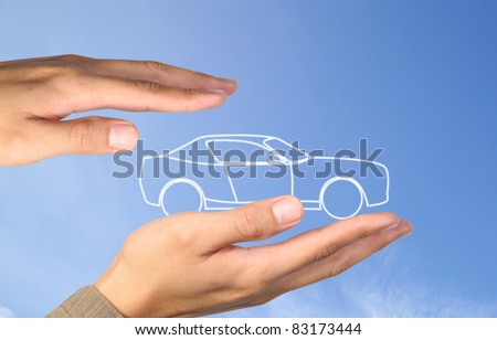 car in hands on blue sky