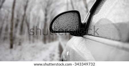car in snow on the forest backgrounds - stock photo