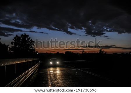Car in the temporal at sunset - stock photo