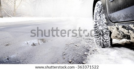 car in the winter - stock photo