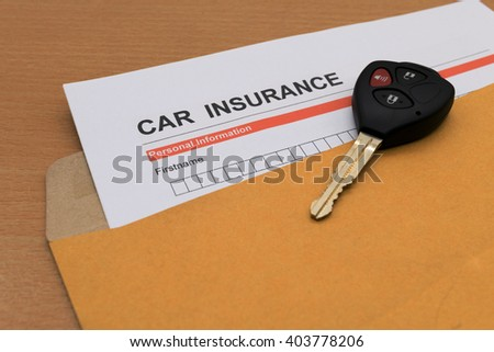 Car Insurance application form and key on brown envelope  - stock photo